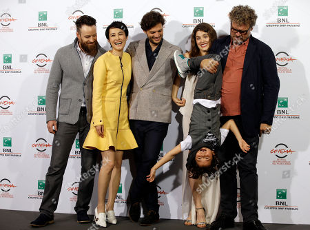 """From left, Actors Daniel Ball, Rinko Kikuchi, Director Director Leonardo Guerra Seragnoli, actors Lucy Griffith, Ken Brady and Yorick van Wageningen pose for photographers during a photo call of the movie """"Last Summer"""" at the Rome Film Festival, in Rome"""