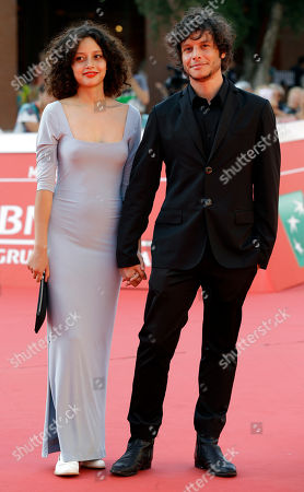 "Director Luis Ortega, right, and actress Ailin Salas pose for photographers on the red carpet for the screening of the movie ""Lulu"" at the Rome Film Festival, in Rome"