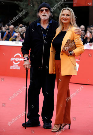 Actor Tomas Milian, left, Barbara Bouchet pose for the photographers on the red carpet at the Rome Film Festival, in Rome