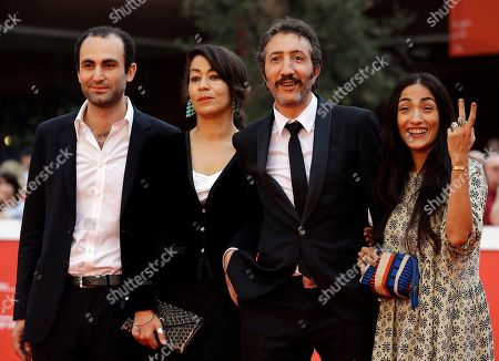 """From left, actor Khalid Abdalla, director Tala Hadid and actors Hocine Choutri and Hindi Zahra pose for photographers on the red carpet on the occasion of the screening of the movie """"The Narrow Frame of Midnight"""" at the Rome Film Festival, in Rome"""