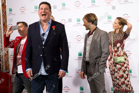 George Hencken, John Keeble, Tony Hadley, Steve Norman Director George Hencken, right, poses with members of the British band of Spandau Ballet, from left, John Keeble, Tony Hadley, Steve Norman during the photo call of the documentary 'Soul Boys of the Western World', in Rome