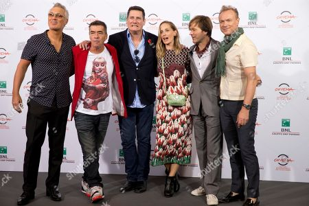 Director George Hencken, third from right, poses with members of the British band of Spandau Ballet, from left, Martin Kemp, John Keeble, Tony Hadley, Steve Norman and Gary Kemp, during the photo call of the documentary 'Soul Boys of the Western World', in Rome