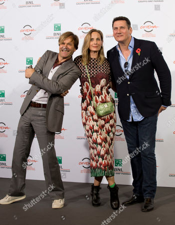 George Hencken, Tony Hadley, Steve Norman Director George Hencken, center, poses with members of the British band of Spandau Ballet, Steve Norman, left, and Tony Hadley, during the photo call of the documentary about the band 'Soul Boys of the Western World', in Rome