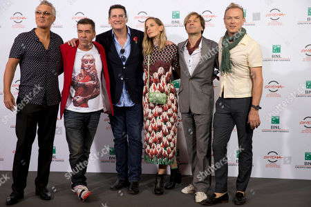 George Hencken, Martin Kemp, John Keeble, Tony Hadley, Steve Norman, Gary Kemp Director George Hencken, third from right, poses with members of the British band of Spandau Ballet, from left, Martin Kemp, John Keeble, Tony Hadley, Steve Norman and Gary Kemp, during the photo call of the documentary 'Soul Boys of the Western World', in Rome