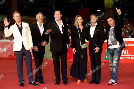 George Hencken, Gary Kemp, Martin Kemp, Tony Hadley, Steve Norman, John Keeble Director George Hencken, third from right, poses with members of the British band of Spandau Ballet, from left, Gary Kemp, Martin Kemp, Tony Hadley, Steve Norman and John Keeble as they arrive for the screening of the documentary 'Soul Boys of the Western World', in Rome