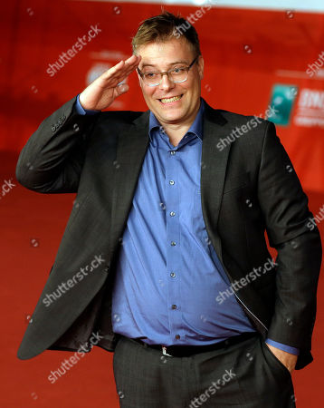 """Director Christoph Hochhausler poses for photographers as he arrives on the red carpet for the screening of the movie """"The Lies of the Victors"""" at the Rome Film Festival, in Rome"""