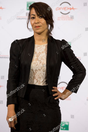 """Director Tala Hadid poses for photographers during a photo call for the movie """"The Narrow Frame of Midnight"""", at the Rome Film Festival, in Rome"""
