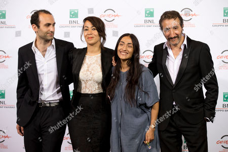 "From left, actor Khalid Abdalla, director Tala Hadid and actors Zahra Hindi and Hocine Choutri pose for photographers during a photo call for the movie ""The Narrow Frame of Midnight"", at the Rome Film Festival, in Rome"