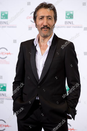 """Actor Hocine Choutri poses for photographers during a photo call for the movie """"The Narrow Frame of Midnight"""", at the Rome Film Festival, in Rome"""