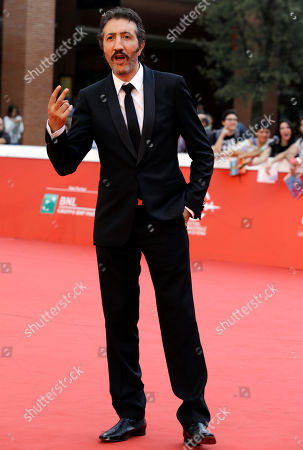 """Actor Hocine Choutri poses for photographers on the red carpet on the occasion of the screening of the movie """"The Narrow Frame of Midnight"""" at the Rome Film Festival, in Rome"""