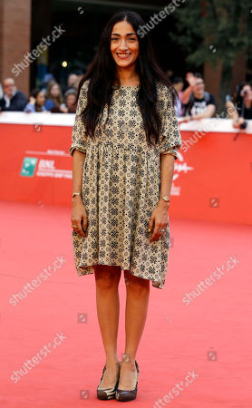"""Moroccan France-based singer Hindi Zahra, poses for photographers on the red carpet on the occasion of the screening of the movie """"The Narrow Frame of Midnight"""" at the Rome Film Festival, in Rome"""