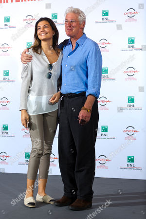 RIchard Gere, Dalia Bayazid Actor Richard Gere poses with actress Dalia Bayazid during the photo call of the movie 'Time Out of Mind' at the 9th edition of the Rome Film Festival in Rome