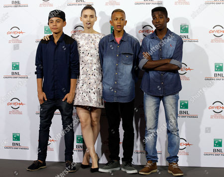 """From left, actors Rickson Tevez, Rooney Mara, Eduardo Luis and Gabriel Weinstein pose for photographers during a photo call of the movie """"Trash"""" at the Rome Film Festival, in Rome"""
