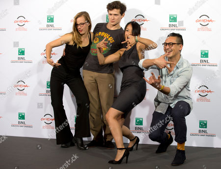 """From left, actors Saskia Rosendahl, Joel Basman, Trang Le Hong and director Burhan Qurbani pose for photographers during a photo call for the movie """"We are young. We are strong."""", at the Rome Film Festival, in Rome"""