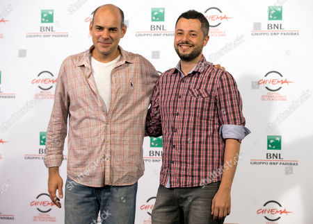 """Director Marco Dutra, right, and actor Marat Descartes pose for photographers during a photo call for the movie """"When I Was Alive"""", at the Rome Film Festival, in Rome"""