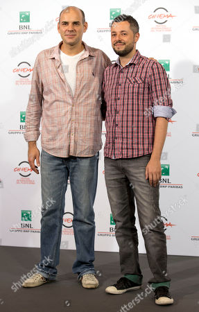 """Stock Image of Director Marco Dutra, right, and actor Marat Descartes pose for photographers during a photo call for the movie """"When I Was Alive"""", at the Rome Film Festival, in Rome"""