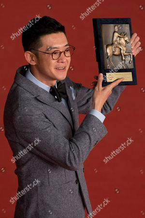 Stock Picture of Director Xu Ang poses for photographers with the 'Cinema d' Oggi' (Today's Filmography) award at the 9th edition of the Rome Film Festival, in Rome