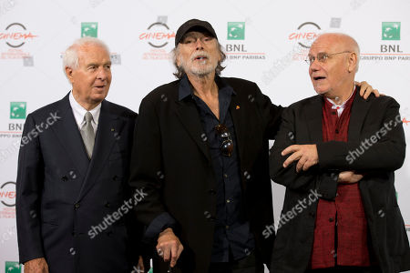 From left, Rome Film Foundation director Paolo Ferrari, actor Tomas Milian and Rome Film Festival director Marco Mueller pose for photographers during a photo call for the opening of the Rome Film Festival, in Rome, . The festival opens Thursday and will run until Oct. 25