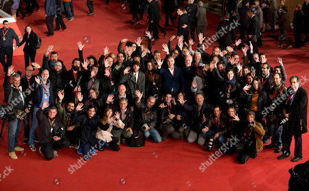 Stock Picture of Rome Film Festival director Marco Muller, center, poses with photographers on the red carpet of the 9th edition of the Rome Film Festival, in Rome