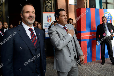 Joey Saputo, left, and Joe Tacopina arrive for a news conference in Bologna, Italy, . A group of North Americans led by New York lawyer Joe Tacopina were presented Thursday as the new owners of Italy's cash-strapped Serie B soccer club Bologna. Tacopina was named club president and Montreal Impact president Joey Saputo is a large investor. Tacopina, who represents New York Yankees slugger Alex Rodriguez in his drug case, resigned from his position on Roma's board to pursue the Bologna deal