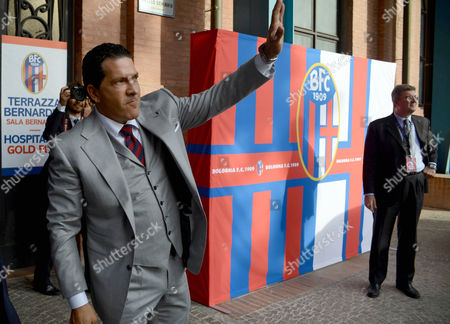 Joe Tacopina waves as he arrives for a news conference in Bologna, Italy, . A group of North Americans led by New York lawyer Joe Tacopina were presented Thursday as the new owners of Italy's cash-strapped Serie B soccer club Bologna. Tacopina was named club president and Montreal Impact president Joey Saputo is a large investor. Tacopina, who represents New York Yankees slugger Alex Rodriguez in his drug case, resigned from his position on Roma's board to pursue the Bologna deal