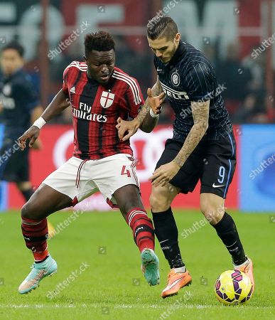 AC Milan's Sulley Muntari, left, challenges for the ball with Inter Milan's Mauro Icardi during the Serie A soccer match between AC Milan and Inter Milan at the San Siro stadium in Milan, Italy