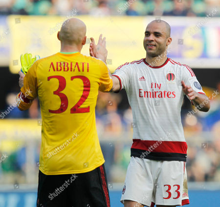 Keisuke Honda AC Milan's Christian Abbiati, left, congratulates teammate Alex at the end of a Serie A soccer match against Hellas Verona at the Bentegodi stadium in Verona, Italy, . AC Milan won 3-1