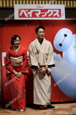 """Miho Kanno, Kotarou Koizumi Japanese actress Miho Kanno, left, and Kotarou Koizumi who voiced characters in the Japanese version of the film """"Big Hero 6 """" attend a press conference in Tokyo, . The film will be shown in Japan from Dec. 20"""
