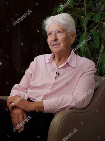 Dawn Fraser Australian swimming great Dawn Fraser, who won the 100-meter freestyle gold medal in 1964 Summer Olympics in Tokyo, speaks during an interview with The Associated Press in Tokyo. While in Tokyo to celebrate the 50th anniversary of the 1964 Olympics, Fraser recalled how the first games in Asia helped her overcome a personal tragedy. She won the 100-meter freestyle at a third consecutive Olympics, but only after overcoming serious injury from a car crash which claimed the life of her mother that same year. Fraser spent nine weeks in a steel brace but recovered to swim an Olympic record in the final