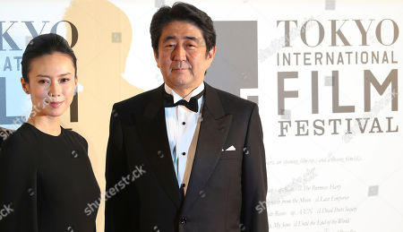 Shinzo Abe, Miki Nakatani Japanese Prime Minister Shinzo Abe poses for photos with Japanese actress Miki Nakatani during the opening ceremony of the 27th Tokyo International Film Festival in Tokyo