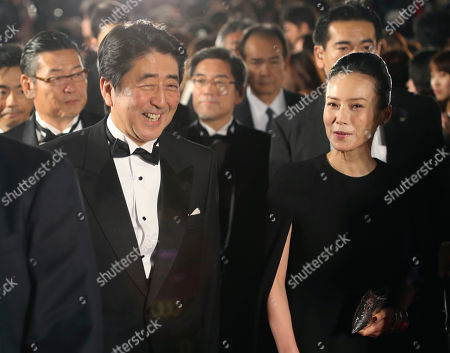 Shinzo Abe, Miki Nakatani Japanese Prime Minister Shinzo Abe walks the red carpet with Japanese actress Miki Nakatani during the opening ceremony of the 27th Tokyo International Film Festival in Tokyo