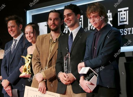 "Stock Picture of Caleb Landry Jones, Ben Safdie, Joshua Safdie, Arielle Holmes, James Gunn From right, actor Caleb Landry Jones, director Ben Safdie, director Joshua Safdie, actress Arielle Holmes and director James Gunn pose for photos after receiving Tokyo Grand Prix award for their film ""Heaven Knows What"" during the award ceremony of the 27th Tokyo International Film Festival in Tokyo"