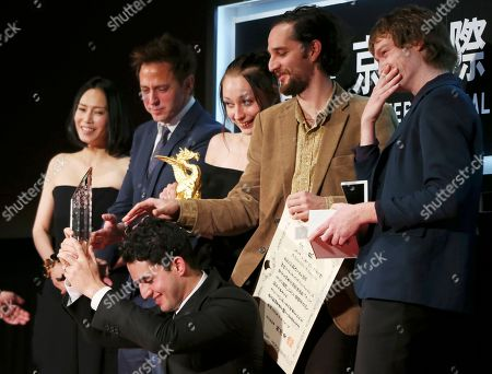 "Caleb Landry Jones, Ben Safdie, Joshua Safdie, Arielle Holmes, James Gunn, Miki Nakatani Tokyo Grand Prix Award winners of their film ""Heaven Knows What"" react after getting honored during the award ceremony of the 27th Tokyo International Film Festival in Tokyo. They are, from right, actor Caleb Landry Jones, director Ben Safdie, actress Arielle Holmes and director Joshua Safdie, director James Gunn and Japanese actress Miki Nakatani"