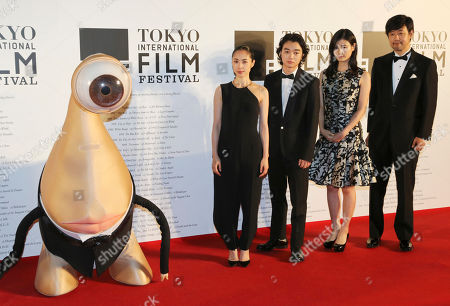 "Takashi Yamazaki, Shota Sometani, Eri Fukatsu, Ai Hashimoto Japanese actor Shota Sometani, second from left, poses with film director Takashi Yamazaki, right, and actors Eri Fukatsu, second from right, Ai Hashimoto, with the character Migi, left, in their latest film ""Parasyte"" at the opening ceremony of the 27th Tokyo International Film Festival in Tokyo. The 22-year-old, who has acted since age 7, has earned a reputation for serious acting in dozens of ambitious Japanese movies. And his gentle air is not superficial technique, but the drive to be a true actor"