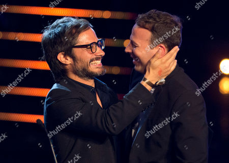 "Gael Garcia, Amat Escalante Mexican actor Gael Garcia, left, greets Mexican filmmaker Amat Escalante moments before Escalante gives his acceptance speech for best director for his film ""Heli"" at the Fenix Iberoamerican Film Awards at the Esperanza Iris Theater in Mexico City"