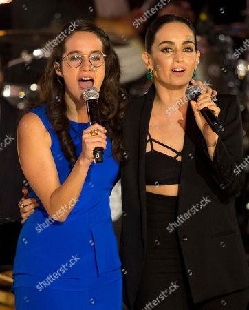 Ximena Sarinana, Ana de la Reguera Mexican singer Ximena Sarinana, left, and Mexican actress Ana de la Reguera perform at the Fenix Iberoamerican Film Awards in Mexico City