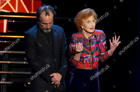 Daniel Gimenez Cacho, Marisa Paredes Spain's actress Marisa Paredes speaks during the Fenix Iberoamerican Film Awards at the Esperanza Iris Theater in Mexico City, . Mexican actor Daniel Gimenez Cacho stands next to her