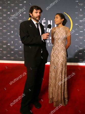 Karen Martinez, Diego Quemada-Diez Guatemalan actress Karen Martinez and Spanish director Diego Quemada-Diez talk to the press during their red carpet walk during the Fenix Iberoamerican Film awards at the Esperanza Iris Theater in Mexico City