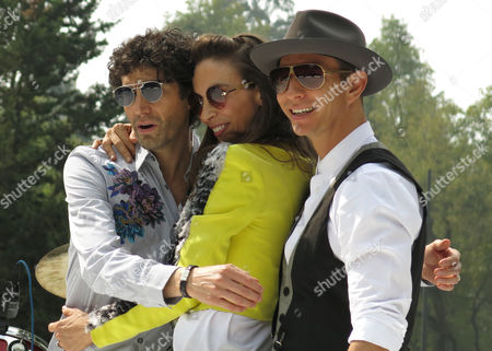 """Mexican singers Benny Ibarra, left, Sasha Sökol, center and Erik Rubin, right poses for pictures during a press conference to promote their new album """"Vuelta al sol"""" on in Mexico City. The singers, who were part of pop band Timbirche, said that their new album gives them a new identity as a group"""