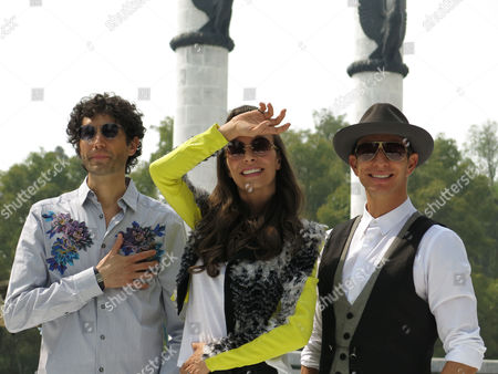 """Mexican singers Benny Ibarra, left, Sasha Sökol, center and Erik Rubin, right pose for pictures during a press conference to promote their new album """"Vuelta al sol"""" on in Mexico City. The singers, who were part of pop band Timbirche, said that their new album gives them a new identity as a group"""
