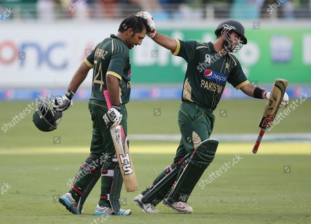 Sarfraz Ahmed, Ahmed Shehzad Pakistani batsman Sarfraz Ahmed, left, receives an encouragement from Ahmed Shehzad after he scored half a century during the second one day international match between Australia and Pakistan in Dubai, United Arab Emirates