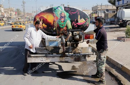 An image of Imam Hussein, a grandson of the Prophet Muhammad, is pasted on a governmental tanker used for drinking water distribution in Sadr City, Baghdad, Iraq. Religious banners and portraits of Imam Hussein hang from homes, bridges, stores and even colleges across much of Baghdad and can be seen even in Sunni-majority areas. They also adorn government buildings and hundreds of security checkpoints across the city, reinforcing Sunni fears that Shiite Prime Minister Haider al-Abadi is no less sectarian than his predecessor Nouri al-Maliki, whose policies were widely seen as aggravating Sunni grievances