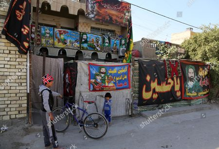Shiite-related banners are seen in Sadr City, Baghdad, Iraq. Religious banners and portraits of Imam Hussein, a grandson of the Prophet Muhammad, hang from homes, bridges, stores and even colleges across much of Baghdad and can be seen even in Sunni-majority areas. They also adorn government buildings and hundreds of security checkpoints across the city, reinforcing Sunni fears that Shiite Prime Minister Haider al-Abadi is no less sectarian than his predecessor Nouri al-Maliki, whose policies were widely seen as aggravating Sunni grievances