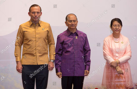 Myanmar President Thein Sein, center and his wife Khin Khin Win, right pose for a picture with Australian Prime Minister Tony Abbott, left during Association of Southeast Asian Nations (ASEAN) and related summits at Myanmar International Convention Center in Naypyitaw, Myanmar