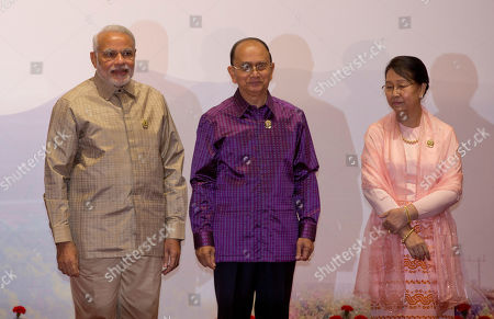 Myanmar President Thein Sein, center and his wife Khin Khin Win, right pose for a picture with Indian Prime Minister Narendra Modi, left during Association of Southeast Asian Nations (ASEAN) and related summits at Myanmar International Convention Center in Naypyitaw, Myanmar