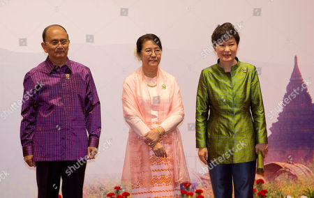 Myanmar President Thein Sein, left and his wife Khin Khin Win, center pose for a picture with President of Republic of Korea Park Geun-Hye during Association of Southeast Asian Nations (ASEAN) and related summits at Myanmar International Convention Center in Naypyitaw, Myanmar