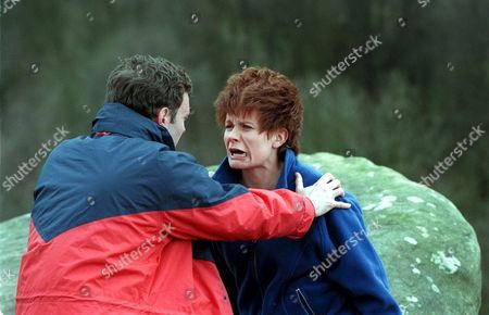 Stock Picture of 'Emmerdale' TV - 1999 - Graham Clark (Kevin Pallister) and Rachel Hughes (Glenda McKay) picnic turns into a nightmare.