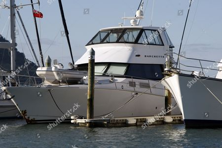 Stock Image of Phil Rudd's motor boat Barchetta sits moored in a marina in Tauranga, New Zealand. The AC/DC drummer faces serious charges and remains secluded in a quiet town that had seemed to accept him and his excesses