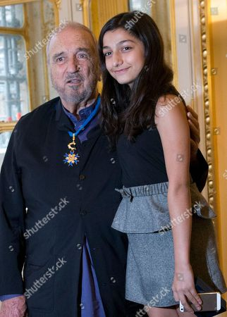"""Jean-Claude Carriere French writer and screenwriter Jean-Claude Carriere, left, poses with his daughter Kiara, 12, after being honored with the medal of Commander of the National Order of Merit during an honor ceremony at Culture ministry in Paris, France. The Academy of Motion Picture Arts and Sciences will present Honorary Awards to Carrière, Hayao Miyazaki and Maureen O'Hara, and the Jean Hersholt Humanitarian Award to Harry Belafonte at the Academy's 6th Annual Governors Awards, in Los Angeles. The 83-year-old novelist, screenwriter and playwright said he was """"astonished"""" and """"filled with joy"""" when he learned he was being recognized for his five-decade film career"""