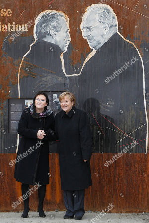 """Angela Merkel, Ewa Kopacz Poland's Prime Minister Ewa Kopacz,left, and German Chancellor Angela Merkel pose in front of a drawing depicting former Polish Prime Minister Tadeusz Mazowiecki,left,and former German Chancellor Helmut Kohl, during a visit of an exhibition to commemorate 25 years since a symbolic reconciliation between the two neighboring nations whose ties were marked by warfare in Krzyzowa, pPoland, . Speaking on the occasion, Merkel stressed that security, freedom and the rule of law are made even more valuable today, when Ukraine's territorial integrity has been violated. """"We are aware that only together with Russia we can assure Europe's long-term security,"""" Merkel said"""